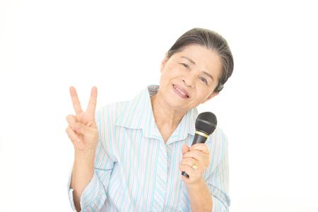 Old woman singing karaoke