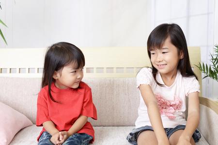 Happy Asian girls smile