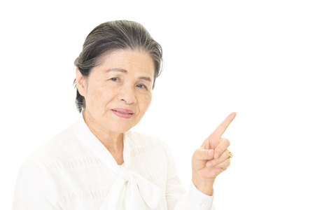 Old woman pointing Stock Photo