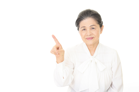 frailty: Old woman pointing Stock Photo