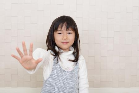 Portrait of girl making stop sign Reklamní fotografie