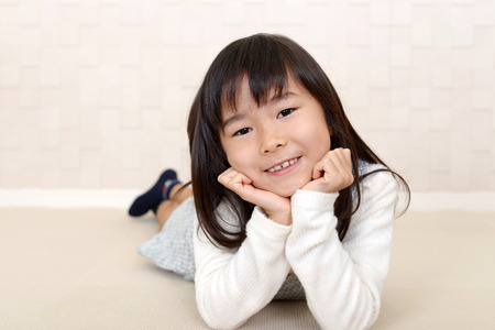 Smiling Asian girl Stock Photo