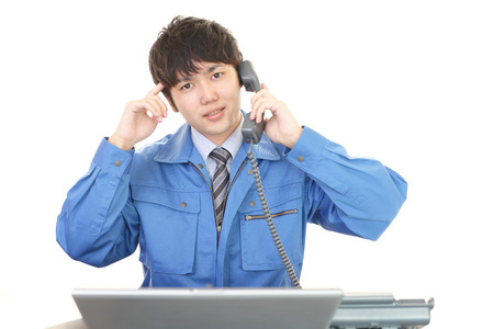 Asian worker in an uneasy look Stock Photo