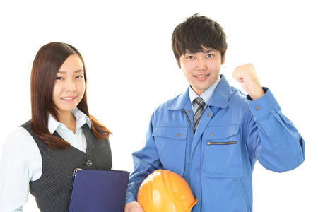 Glimlachende arbeider met bedrijfsvrouw Stockfoto