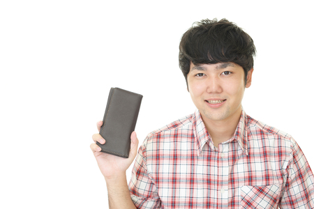 Smiling Asian man with a wallet