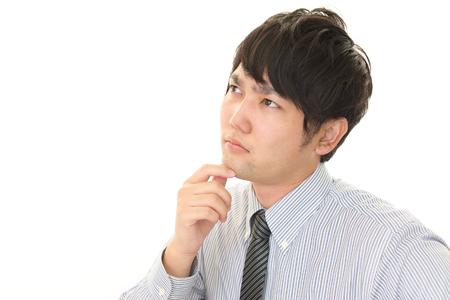 Portrait of businessman looking uneasy Stock Photo