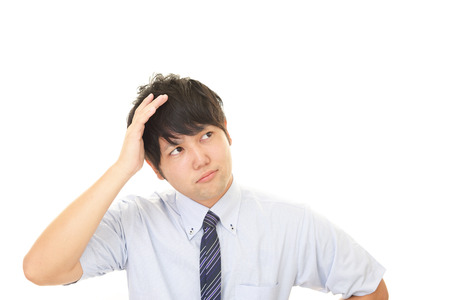 uneasy: Portrait of businessman looking uneasy Stock Photo