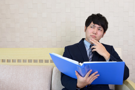 Uneasy Asian businessman