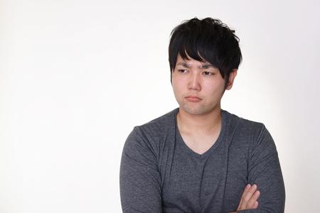 Dissatisfied Asian man 版權商用圖片