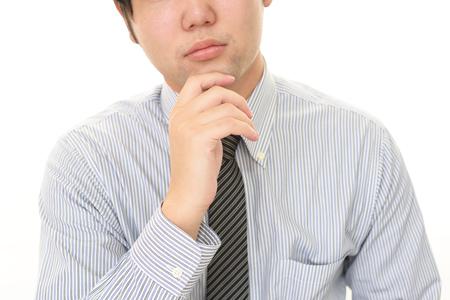 Portrait of businessman looking uneasy 写真素材