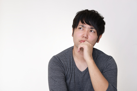 Dissatisfied Asian man Stockfoto