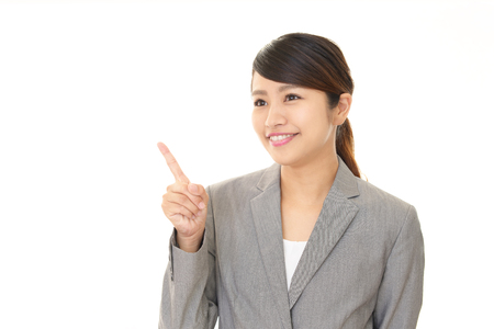 Business woman pointing with her finger