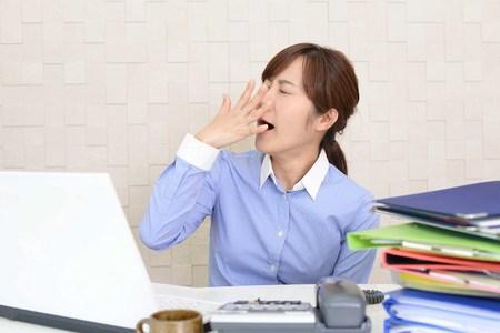 Sleepy Asian business woman yawning