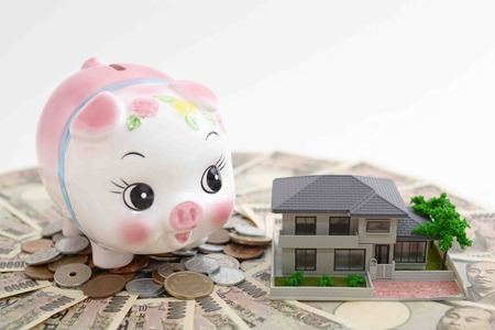 Piggy bank with house model