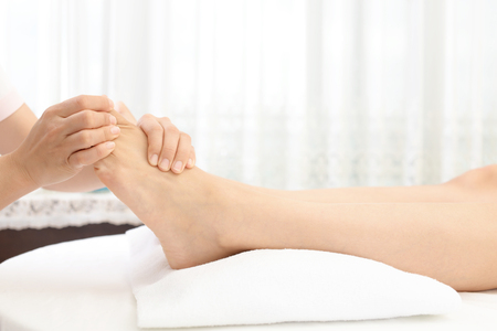 Foot massage in spa salon Archivio Fotografico