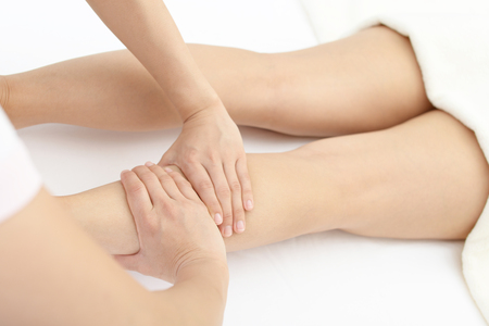 Close-up of leg receiving massage in spa