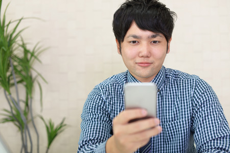 Businessman looking at smart phone