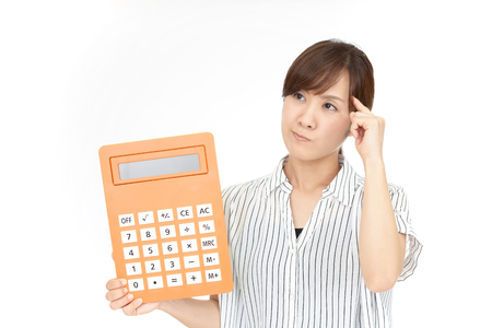 Disappointed woman with a calculator