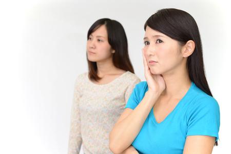 Uneasy Asian women Stock Photo