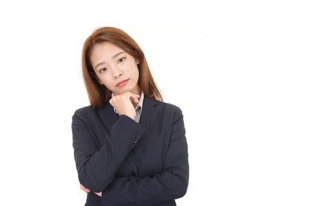 Portrait of business woman looking uneasy  isolated on white