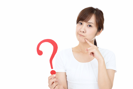 Woman with a question mark  isolated on white