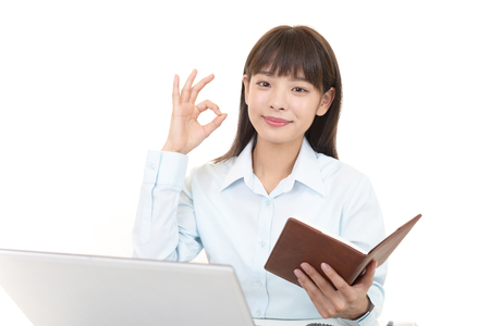 Business woman with ok hand sign Stock Photo