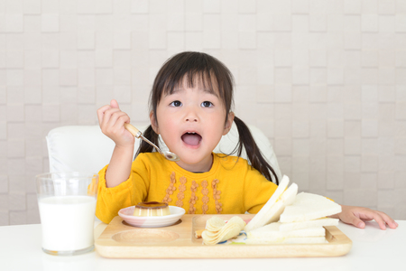 Happy girl eating meals