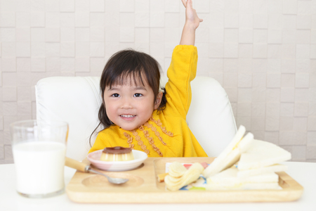 Cute girl eating meals