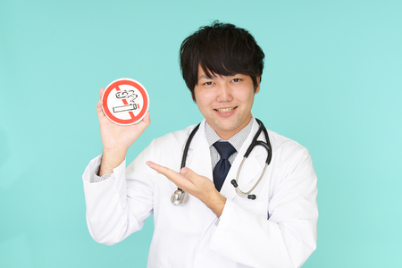 Doctor holds non smoking sign