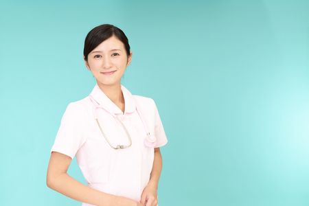 Smiling female nurse Stock Photo