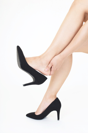 Woman feet pain wear high heel shoes 写真素材