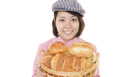 A smiling female baker  isolated on white Banque d'images