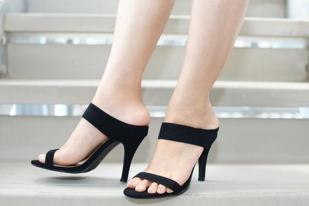 Woman wearing high-heeled sandals