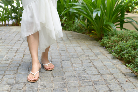 Woman wearing flip flops Archivio Fotografico - 95011564