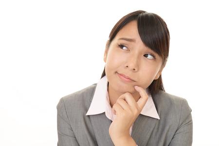 Portrait of business woman looking uneasy