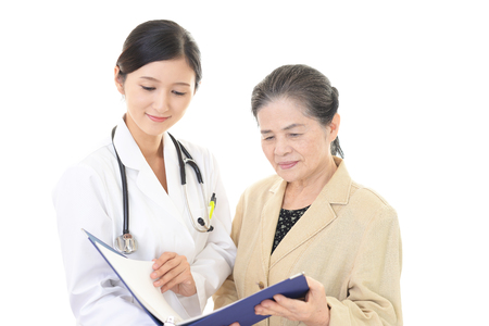 A friendly female doctor and an elderly woman Banco de Imagens