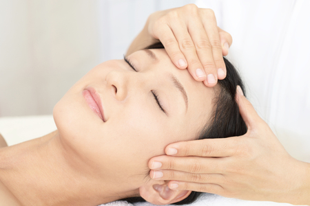 Woman getting a facial massage Standard-Bild