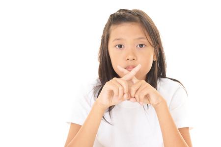 Girl demonstrating prohibiting gesture