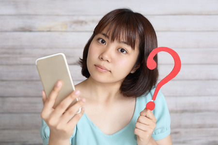 Asian teen girl with a smart phone