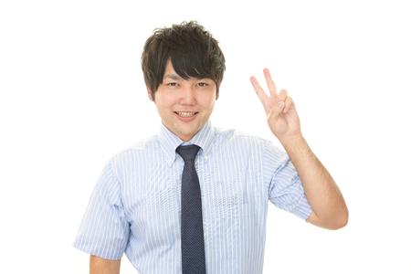 The male office worker who poses happily