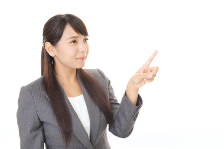 Asian business woman pointing 版權商用圖片