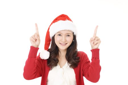 Young woman in Santa Claus cap