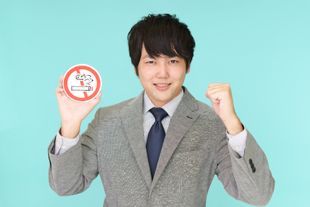 Man holds non smoking sign 스톡 콘텐츠
