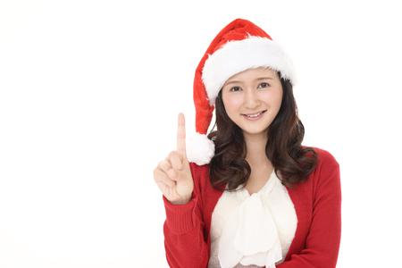 Young woman in Santa Claus cap