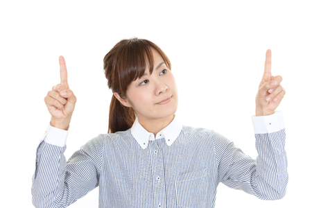 Business woman pointing upward