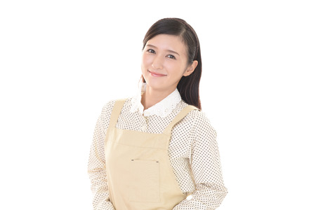 Smiling woman in apron 写真素材