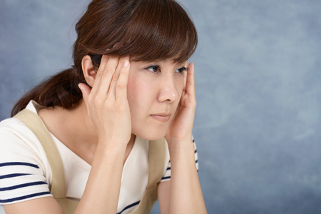 Woman who has a headache Archivio Fotografico