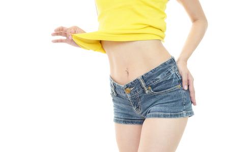 Sexy woman in fashion blue jeans shorts Standard-Bild