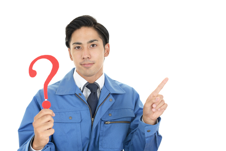 Asian worker with a question mark Banque d'images