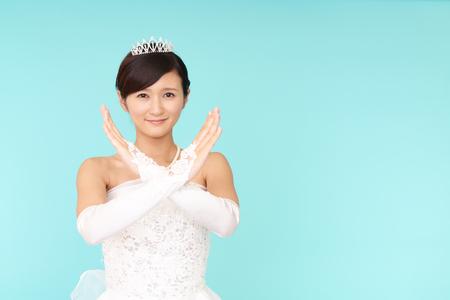 Beautiful bride demonstrating prohibiting gesture